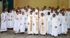 The 2 new priests with the ordaining Bishop and the concelebrants