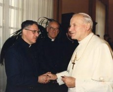 Fr. Donat Lamothe (left) meets Pope John Paul II for the first time in 1986. Fr. Wilfrid Dufault, A.A. can be seen in the background