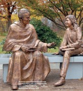 The bronze statue of Assumptionist founder Emmanuel d'Alzon with a student