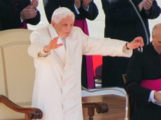 Pope Benedict XVI waves to the faithful during his last general audience in St Peter's Square