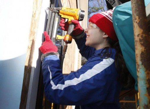 Assumption College students repair homes in Tuscaloosa