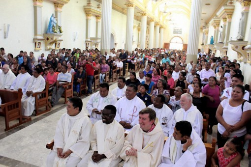 packed main church at installation Mass